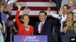Republican presidential candidate Sen. Ted Cruz, R-Texas, and former Hewlett-Packard CEO Carly Fiorina wave during a rally in Indianapolis, April 27, 2016, when Cruz announced he has tapped Fiorina to serve as his running mate.