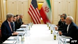 FILE - U.S. and Iranian delegations headed by Secretary of State John Kerry (L) and Iranian Foreign Minister Javad Zarif (R) are seen meeting in Vienna, Austria, Jan. 16, 2016. Critics on Capitol Hill have accused the Obama administration of a lack of transparanecy during Iran nuclear talks.