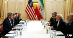 US Secretary of State John Kerry (L) meets with Iranian Foreign Minister Javad Zarif (2R) in Vienna, Austria on Jan. 16, 2016.