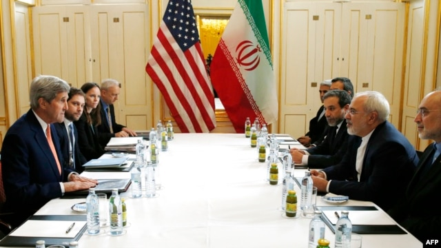 "US Secretary of State John Kerry (L) meets with Iranian Foreign Minister Javad Zarif (2R) in Vienna, Austria on Jan. 16, 2016, on what is being referred to as ""implementation day,"" the day the IAEA verifies that Iran has met all conditions under the nuclear d"