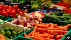 Fresh assorted vegetables in boxes at a farmers' market. (FILE PHOTO)