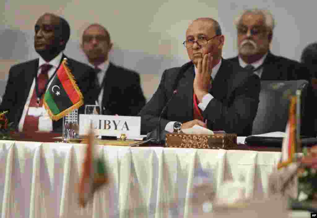 Foreign ministers from Egypt, Libya, Algeria, Tunisia, Sudan, and Chad, as well as the Arab League Secretary General, met together to address the weeks of inter-militia fighting that has wreaked havoc in Libya, in Cairo, Egypt, Aug. 25, 2014.