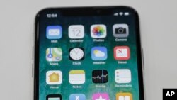 The new iPhone X is displayed in the showroom after the new product announcement at the Steve Jobs Theater on the new Apple campus on Sept. 12, 2017, in Cupertino, Calif.