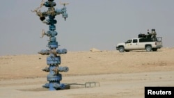 An Iraqi army vehicle secures the Akkas gas field in the western desert of Iraq, Oct. 19, 2010.