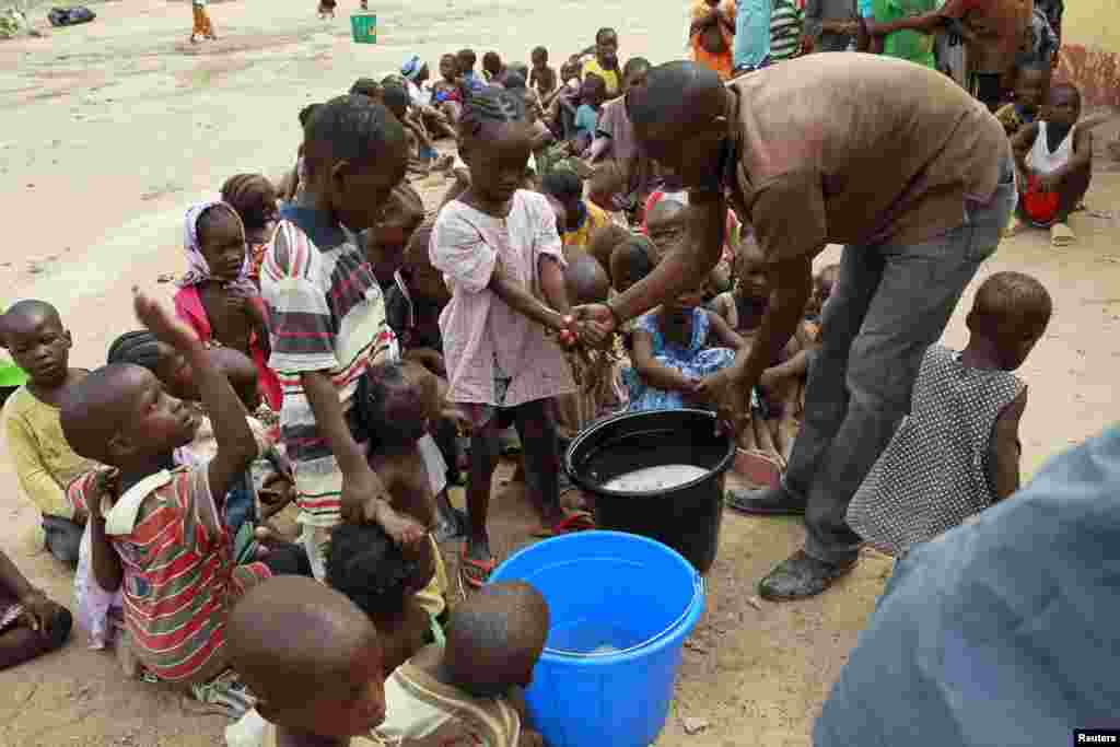Children rescued from Boko Haram in Sambisa forest wash their hands at the Malkohi camp in Yola, May 3, 2015.