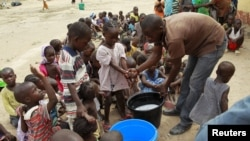 FILE - Children rescued from Boko Haram in Sambisa forest wash their hands at the Malkohi camp for Internally Displaced People in Yola, Adamawa State, Nigeria, May 3, 2015.