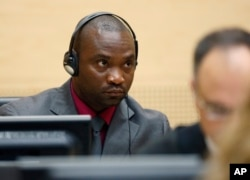 Germain Katanga, a Congolese national, sits in the courtroom of the ICC during the closing statements in the trial against Katanga and Mathieu Ngudjolo in The Hague, Netherlands, May 15, 2012