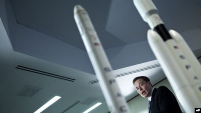 Elon Musk, CEO of Space Exploration Technologies Corp, speaks during a news conference in Washington, DC. to announce SpaceX's Falcon Heavy rocket should be ready for use by the end of 2012, April 5, 2011