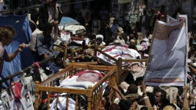 Anti-government protestors carry the bodies of those who were killed during recent clashes with security forces during their funeral procession in Sanaa, Yemen, September 25, 2011.