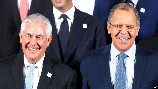 FILE - Russian Foreign Minister Sergey Lavrov, right, and U.S. Secretary of State Rex Tillerson stand together during the G-20 foreign ministers meeting in Bonn, Germany, Feb. 16, 2017.