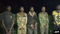Nesta imagem de arquivo, alegados membros das FDLR capturados no Ruanda.