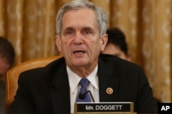 FILE - Rep. Lloyd Doggett, D-Texas, speaks during a House Ways and Means Committee hearing on Capitol Hill in Washington, June 4, 2013.