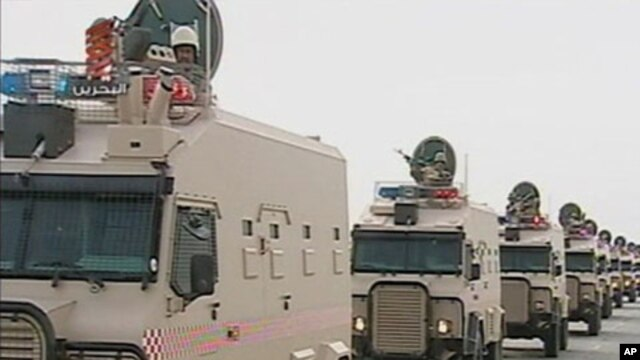 Saudi Arabian troops cross the causeway leading to Bahrain in this still image taken from video on March 14, 2011