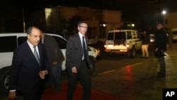 FILE - In this Jan. 9, 2015 photo, U.N. Special Envoy to Libya Bernardino Leon, center, arrives in Tripoli for meetings.