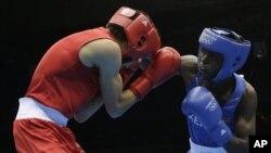 Kenya's Benson Njangiru fights Egypt's Hesham Abdelaal, left, in boxing match at 2012 Summer Olympics July 30, 2012.