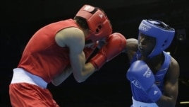 Kenya's Benson Njangiru fights Egypt's Hesham Abdelaal, left, in boxing match at 2012 Summer Olympics July 30, 2012.