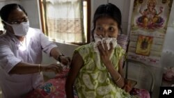 A tuberculosis patient receives treatment at the TB Hospital in Gauhati, India, March 24, 2012.