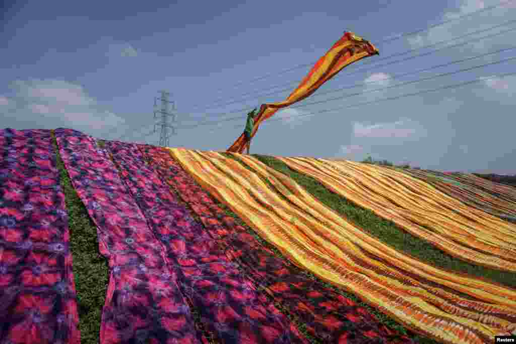 A worker throws a cloth during a drying process at Sukoharjo near Solo, Central Java province, Indonesia, in this photo taken by Antara Foto.