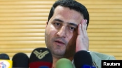 FILE - Iranian scientist Shahram Amiri speaks to journalists as he arrives at the Imam Khomini Airport in Tehran, July 15, 2010. Iran has executed id Amiri who was convicted of giving top secret information about Tehran's controversial nuclear program to the United States.
