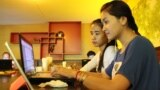 FILE PHOTO- University students from the Royal University of Phnom Penh check the Internet in a coffee shop along the city's Russian Federation Boulevard, June 13, 2014. (Suy Heimkhemra/VOA Khmer)