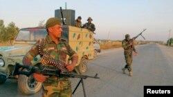 Curf el-Sahar kasabası dışında güvenlik önlemleri alan Şii milisler