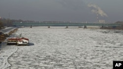 The Vistula River is covered with ice floe near the old town of Warsaw, Poland, January 31, 2012.