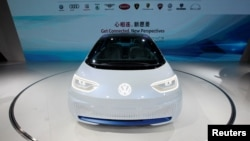 A Volkswagen I.D. electric vehicle is shown at a news conference in Guangzhou, China, Nov. 17, 2016.