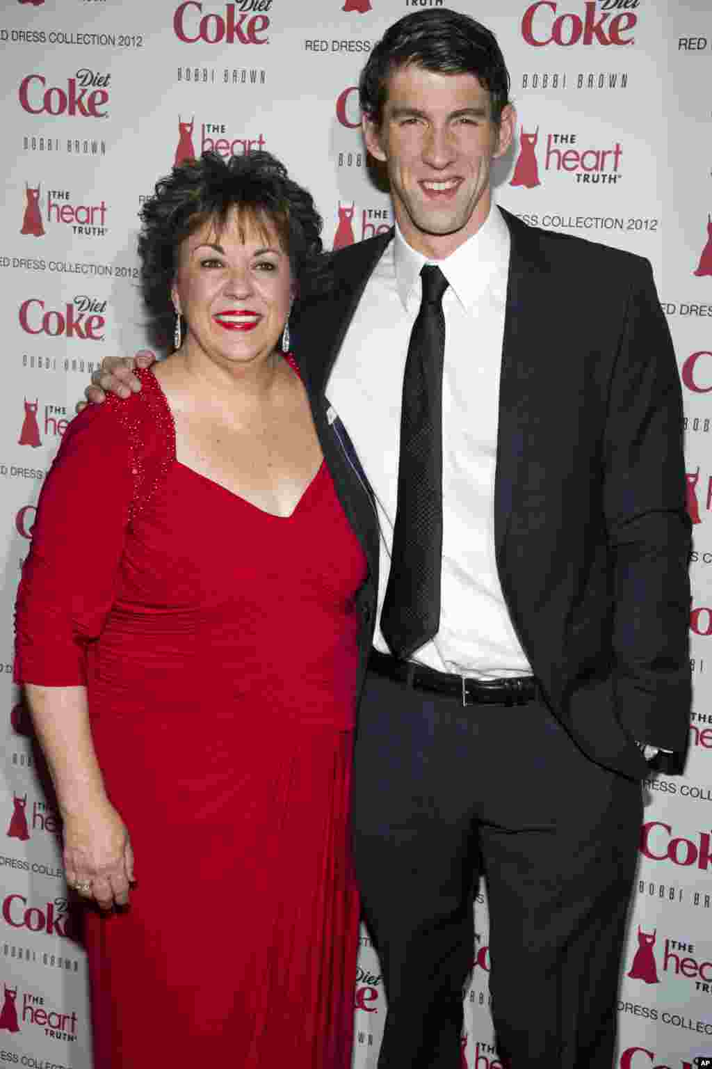 Michael Phelps and his mother Debbie Phelps attend the Heart Truth's Red Dress Collection during Fashion Week in New York, February 8, 2012.