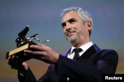 "Director Alfonso Cuaron's ""Roma"" won the Golden Lion for Best Film at the Venice Film Festival in Venice, Italy, Sept. 8, 2018."
