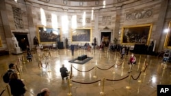 Staff prepare for the late Rev. Billy Graham to be honored Wednesday in the Rotunda of the Capitol Building, Feb. 27, 2018 in Washington.