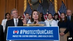 Speaker of the House Nancy Pelosi, D-Calif., joined at left by Energy and Commerce Committee Chair Frank Pallone, D-N.J., speaks at an event to announce legislation to lower health care costs and protect people with pre-existing medical conditions, Washington, March 26, 2019.