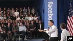 President Barack Obama and Facebook CEO Mark Zuckerberg take part in a town hall meeting to discuss reducing the national debt, April 20, 2011, at Facebook headquarters in Palo Alto, Calif.