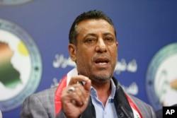 Iraqi lawmaker, Hakim al-Zamili, speaks to the media during press conference, in Baghdad, April 18, 2016.