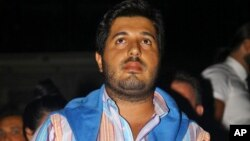 FILE - Turkish-Iranian businessman Reza Zarrab, who is charged in the U.S. for evading sanctions on Iran, watches a concert in Istanbul, Sept. 8, 2013.
