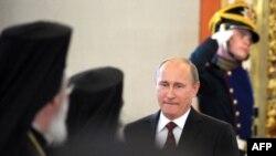 Росія - Путін під час зустрічі з православними лідерами в Кремлі, Москва, 25 липня 2013 року
