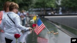 Visitors touch the names of the victims of the Sept. 11, 2001, terror attacks at New York's National September 11 Memorial, Sept. 11, 2015. Survivors and relatives of the nearly 3,000 people killed in the attacks might be able to soon sue Saudi Arabia for damages.