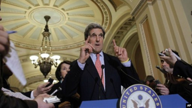 Sen. John Kerry, D-Mass., center, speaks as Sen. Dianne Feinstein, D-Calif., left, listens after an unusual closed Senate session in the Old Senate Chamber on Capitol Hill in Washington Monday, Dec. 20, 2010.