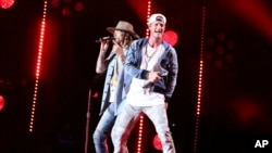 FILE - (L-R) Brian Kelley and Tyler Hubbard of Florida Georgia Line perform at the 2017 CMA Music Festival at Nissan Stadium on June 10, 2017 in Nashville, Tenn.
