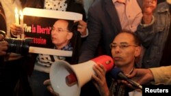 FILE - Maati Monjib, a professor of political history and African studies at the University of Rabat and a writer for national and international news organisations, and his supporters participate in a demonstration near the Moroccan Human Rights Associati