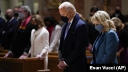 FILE - In this Wednesday, Jan. 20, 2021 file photo, President-elect Joe Biden and his wife, Jill Biden, attend Mass at the Cathedral of St. Matthew the Apostle during Inauguration Day ceremonies in Washington. (AP Photo/Evan Vucci, File)