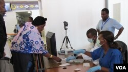 CDC epidemiologist Kerton Victory observes medical students conducting exit screening at Guinea's Conakry International Airport on Sept. 24, 2014.