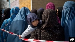 Afghan women in line queuing to get their registration cards on the last day of voter registration for the presidential elections, April 1.