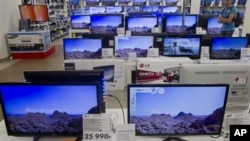 TV sets seen on a shop display on Wednesday afternoon, Aug. 22, 2012 in Moscow Russia.