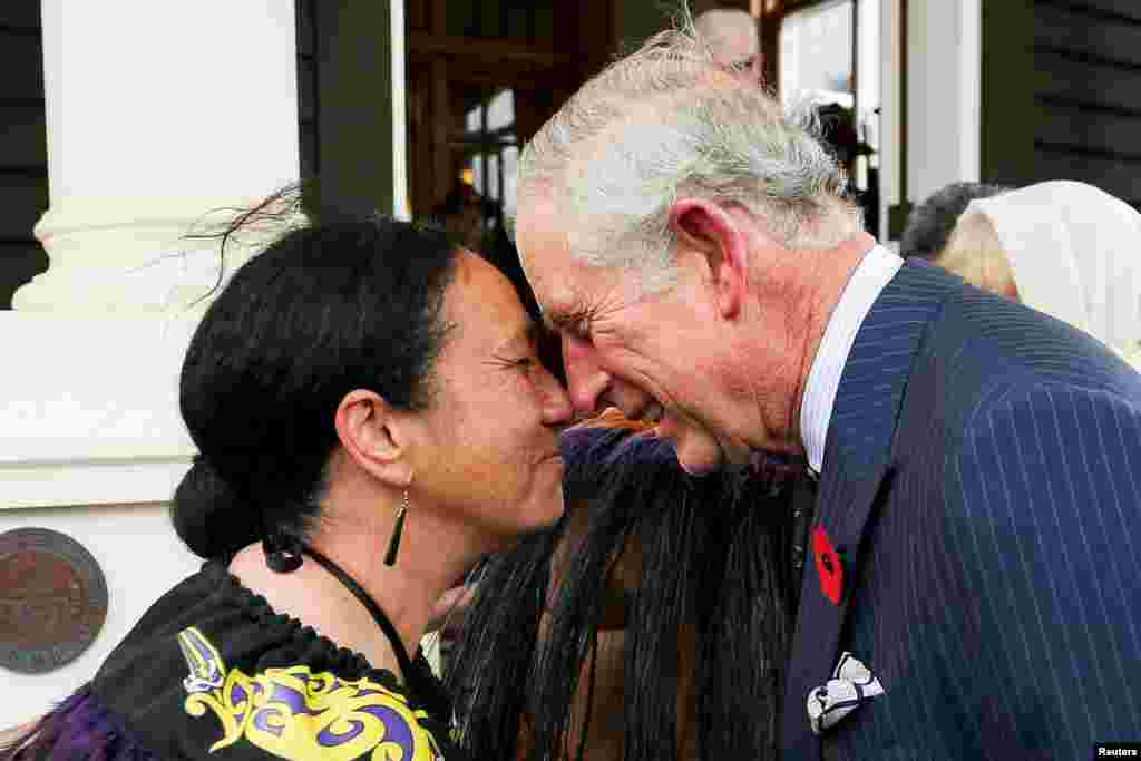 Prince Charles, Prince of Wales, is welcomed with a hongi (a traditional Maori greeting) from New Zealand Defence Force Flight Sergeant Wai Paenga during a welcome ceremony at Government House in Wellington.