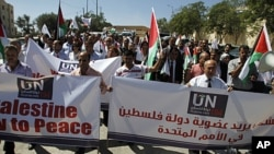Palestinians march during the launch of a campaign supporting a bid for Palestinian statehood recognition at the UN, in the West Bank city of Ramallah, September 8, 2011.