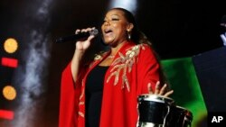 FILE - Queen Latifah performs at the 2018 Essence Festival at the Mercedes-Benz Superdome in New Orleans, Louisiana, July 7, 2018. Latifah will host the 2018 Black Girls Rock awards, which will be taped Aug. 26 at the New Jersey Performing Arts Center in Newark.