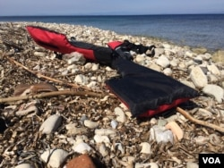 A life jacket discarded on the beach as refugees and other migrants are still arriving by the hundreds daily, according to people inside the refugee camp in Lesbos, Greece, April 1, 2016. (H. Murdock/VOA)