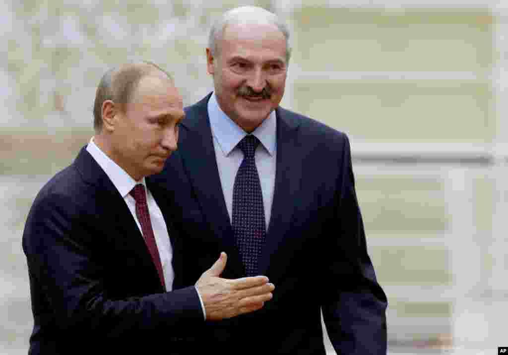 Belarus President Alexander Lukashenko, right, welcomes Russian President Vladimir Putin, in Minsk, Belarus, Feb. 11, 2015.