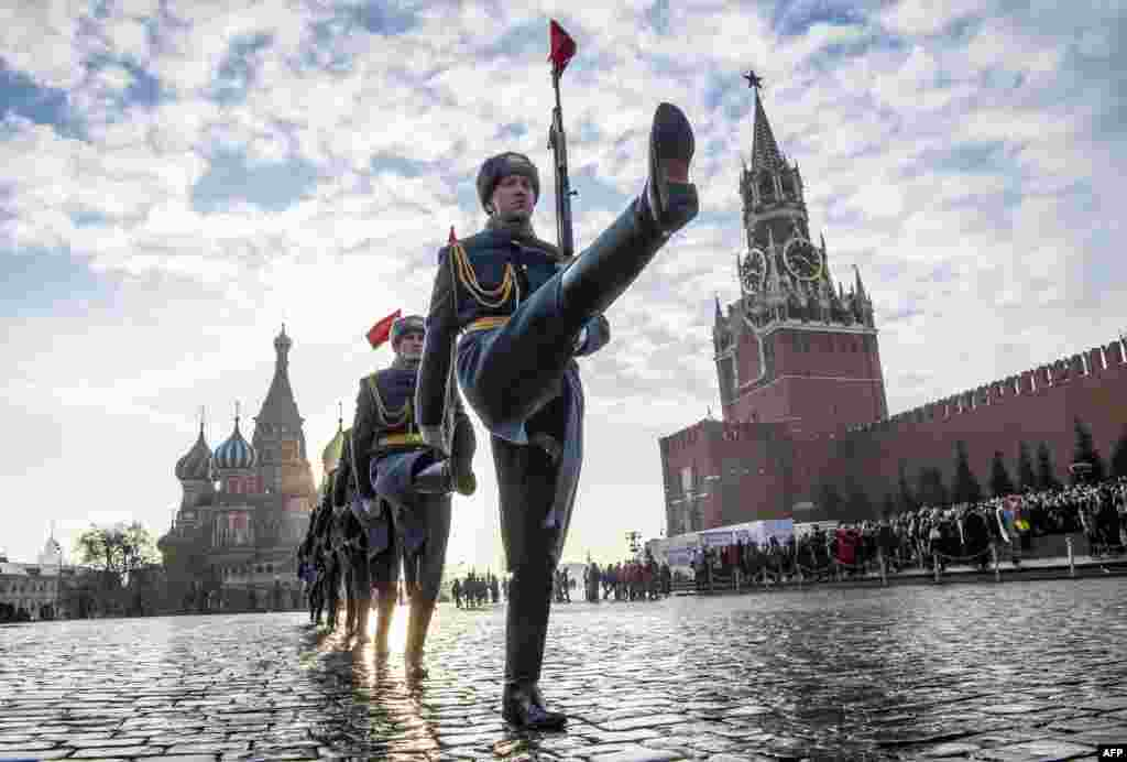 Russian honor guards march during the military parade at Red Square in Moscow.