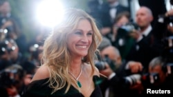 "FILE - Cast member Julia Roberts poses on the red carpet as she arrives for the screening of the film ""Money Monster"" out of competition at the 69th Cannes Film Festival in Cannes, France, May 12, 2016."
